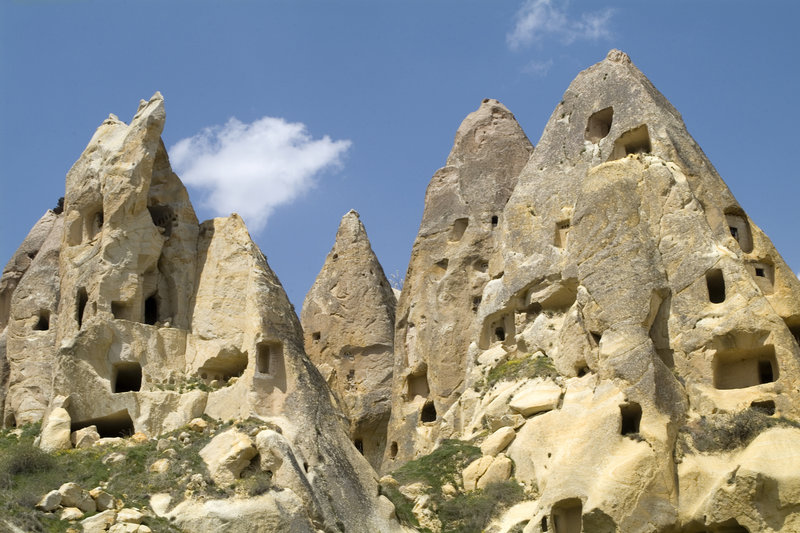 Fairy chimneys filled with houses near the village of Uç