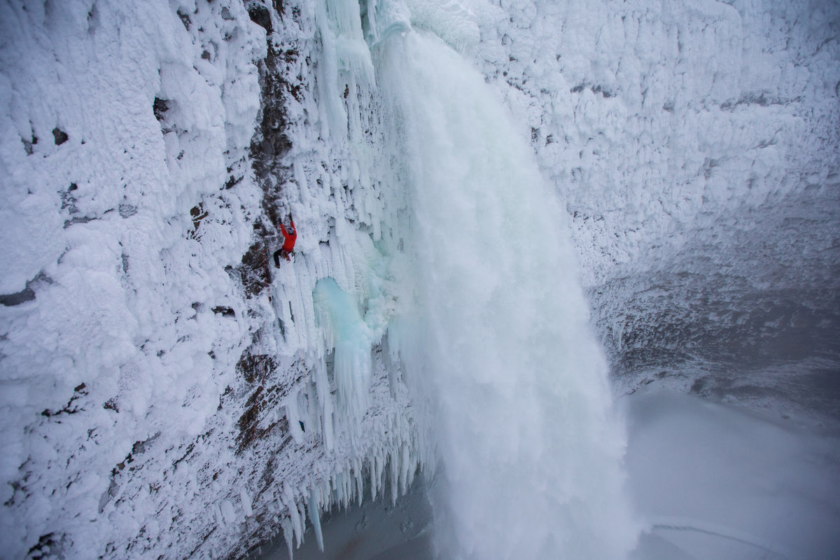 Will Gadd climbing a first ascent on a mixed route Overhead Hazard at Helmcken Falls in Wells Gray Provincial Park, BC - Canada.